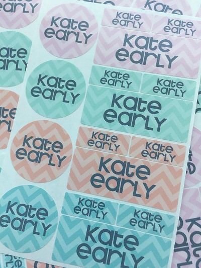 "Adorable set of 64 name labels in assorted sizes. Perfect for labeling lunchware, school supplies, personal items, daycare gear, pool toys and more! Set includes 16 round labels (1.5"") + 16 oblongs (1""x2.5"") + 32 minis (1.25""x0.5""). Personalized with any name or a name with phone number. Labels are dishwasher-safe; avoid detergents with chlorine bleach."